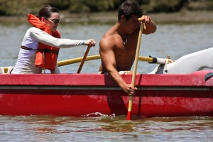 Hawaiian outrigger canoeist takes visitor for a paddle