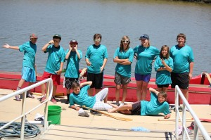 Campers relax by a Hawaiian outrigger canoe, day 2!
